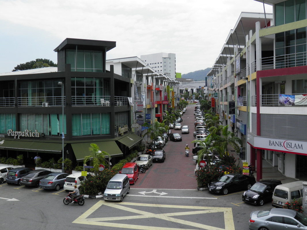 Modern shopping development in front of Rawang station.